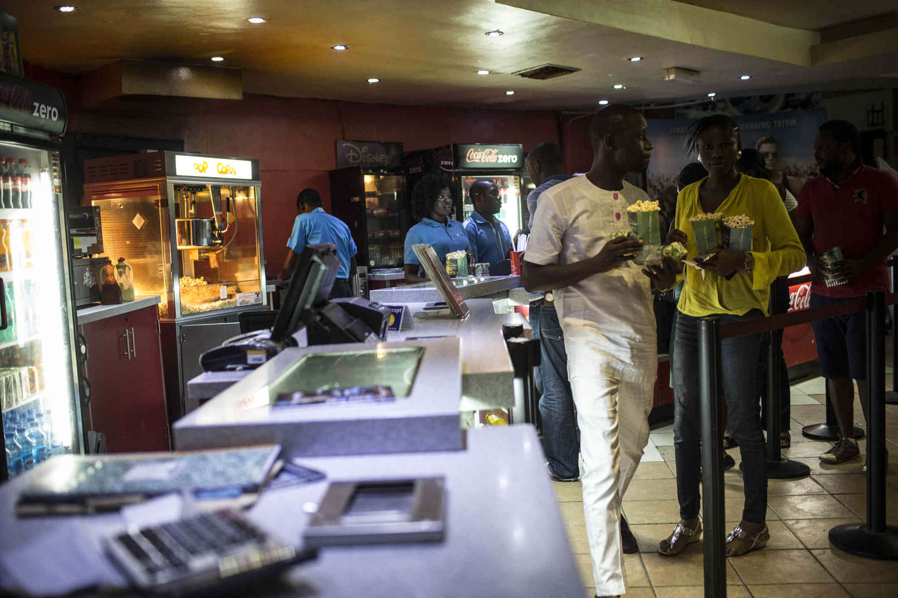 Movie goers wait in line to buy popcorn at Silverbird, one of only three movie theaters in Lagos, a city of nearly 20 million. Most people watch movies at home or in informal settings, though Western blockbusters and the occasional Nollywood hit still get some screen time.