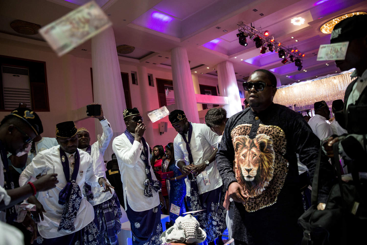 A posh wedding in Lekki, Nigeria, filled with many from the music and film industry, is complete with {quote}spraying{quote} - throwing money in the air in the bride and groom's direction.