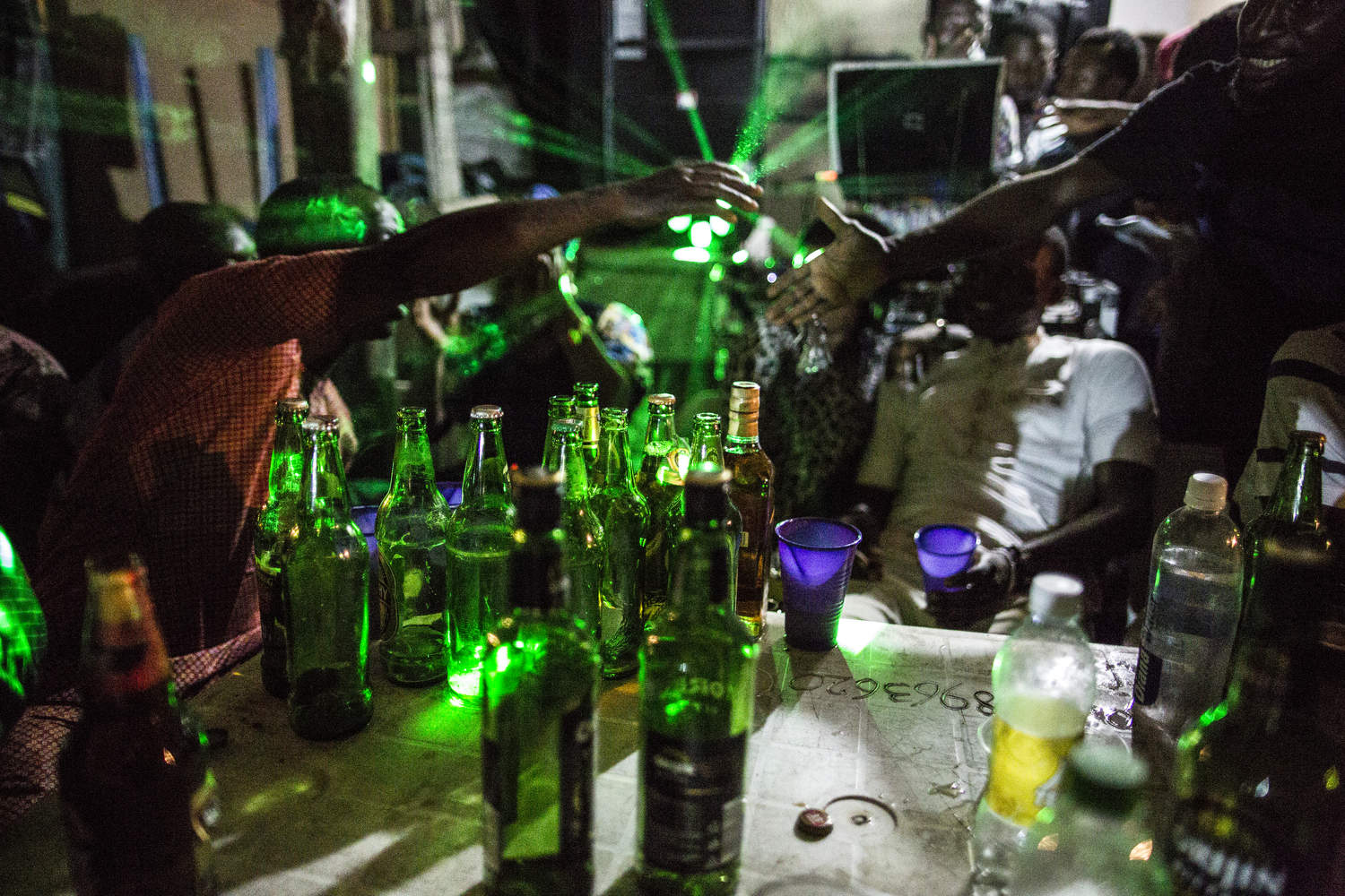 A Lagos Island street party on a Friday night is filled with many neighborhood types drinking Star beer and listening to young musicians practicing their best numbers.