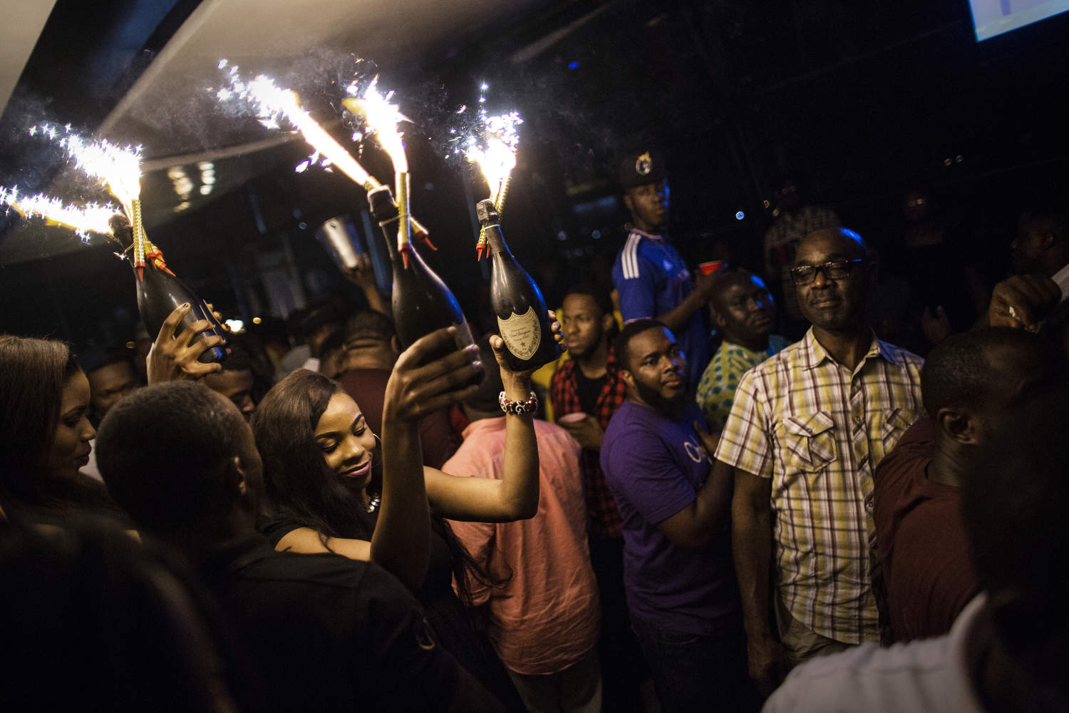Bottle service is a common part of club culture and when people order bottles, girls bring them out with sparklers.