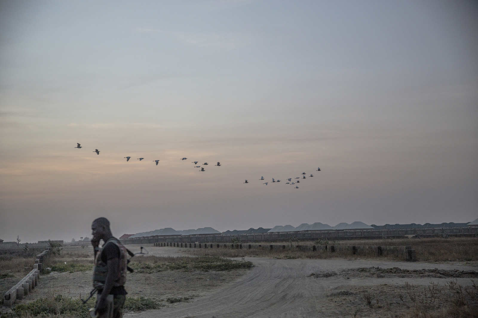 A solider at dusk near the edges of Maiduguri.