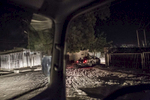 Military vehicles drive through the night to follow up on a suicide bombing attempt on the outskirts of Maiduguri, Nigeria.