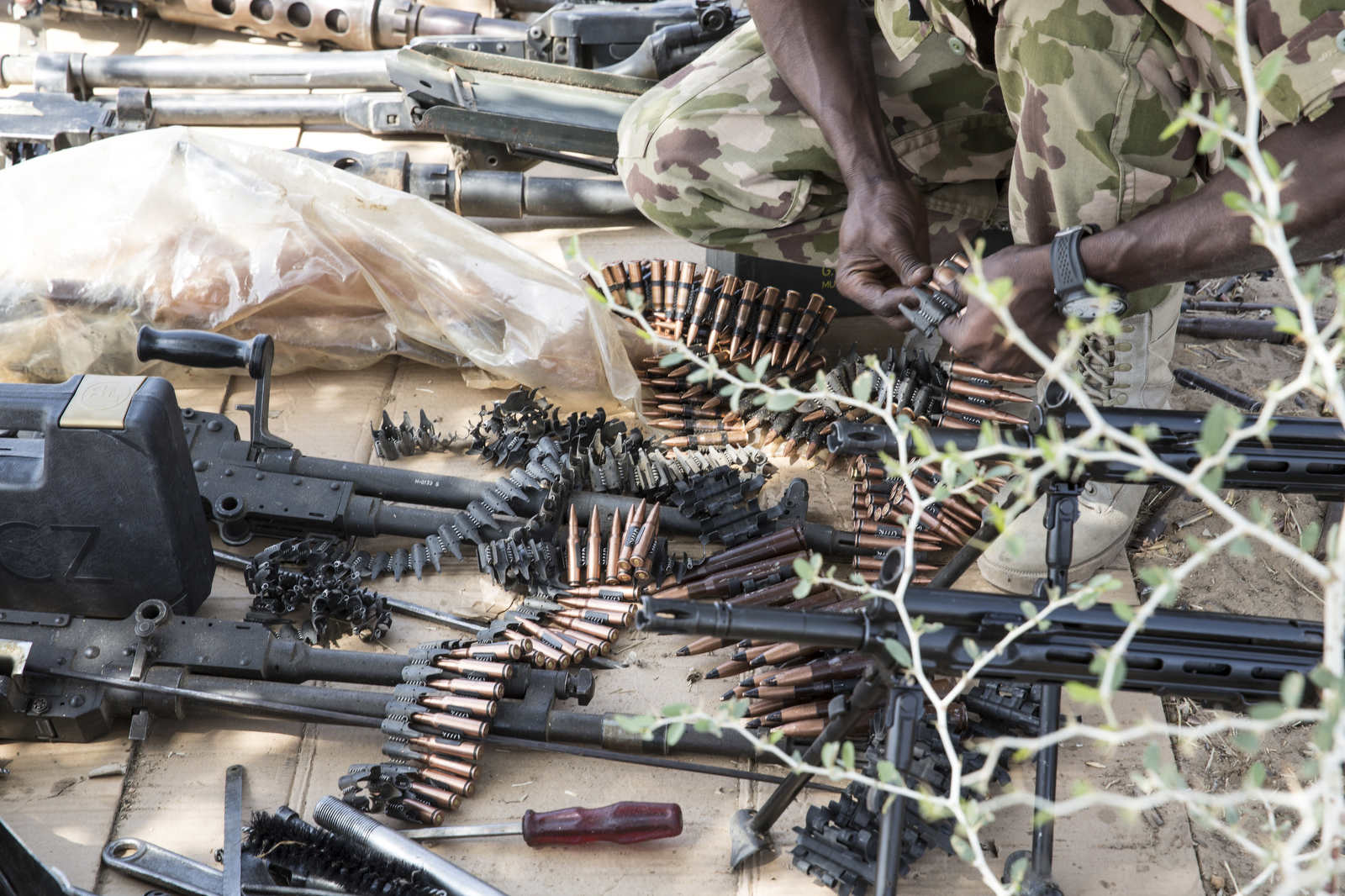 A solider organizes bullets and magazines on the shooting range at Theater Command, the base of the Nigerian military in Borno State.