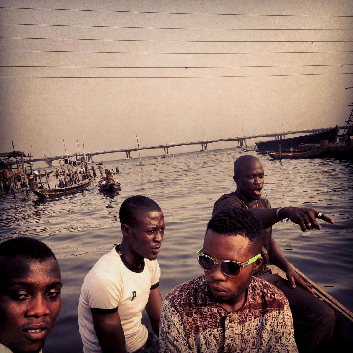 Riding a boat through Makoko, a slum on the water in Lagos, Nigeria, on the way to a Christmas party. December 2012.