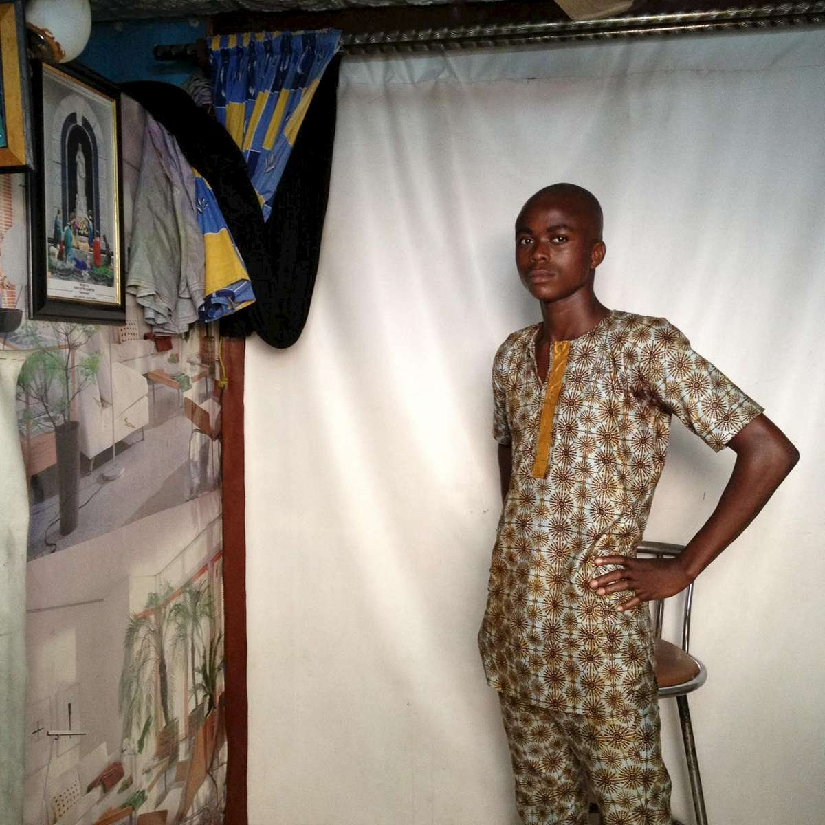 A man gets his portrait taken at Sammy\'s Photo Studio in Obalende, a transit hub in Lagos, Nigeria on January 4.