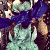 Tying a gele, a head wrapper, at a wedding in Nigeria. January 2013.