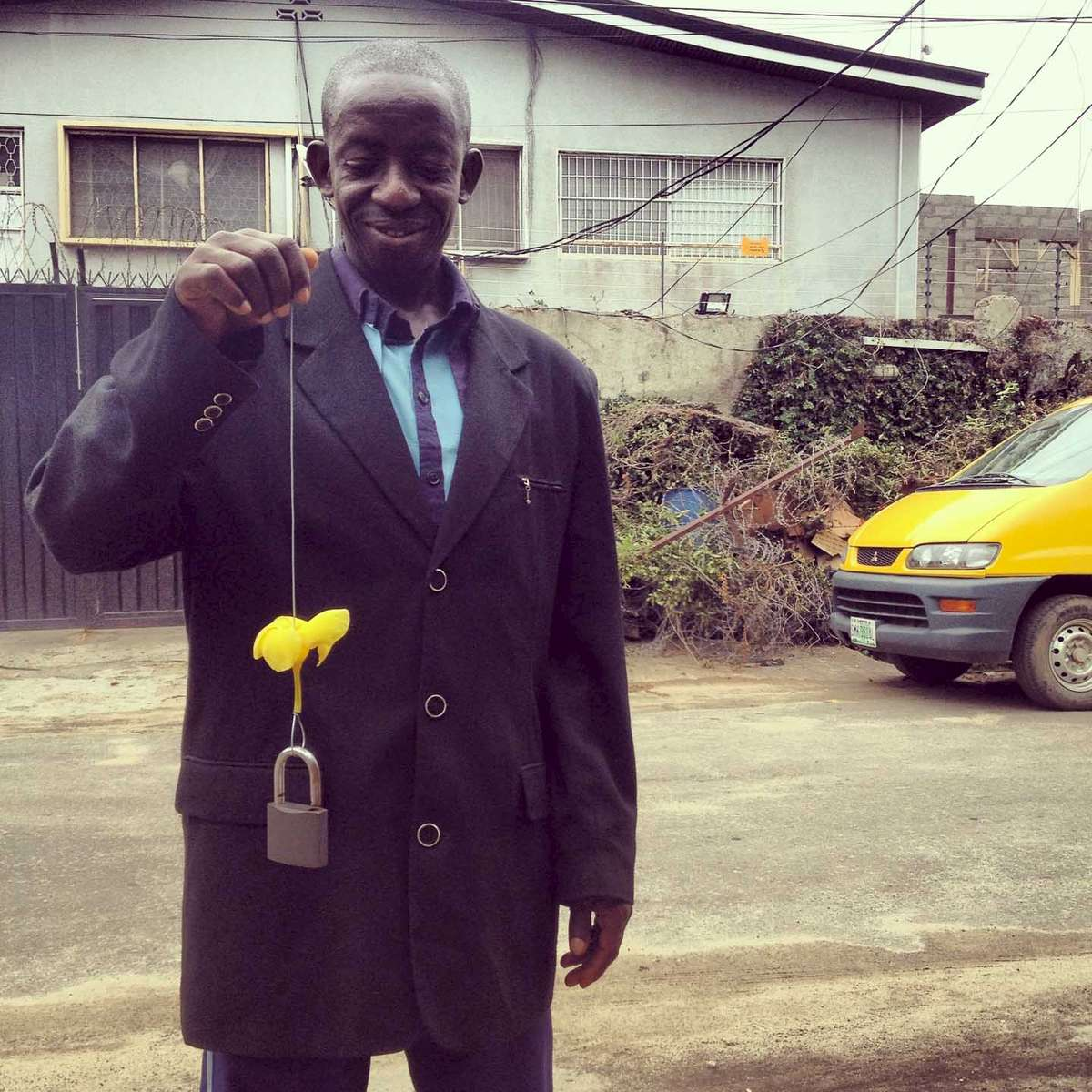 A man with a flower and a lock. Lagos, Nigeria. October 2012.