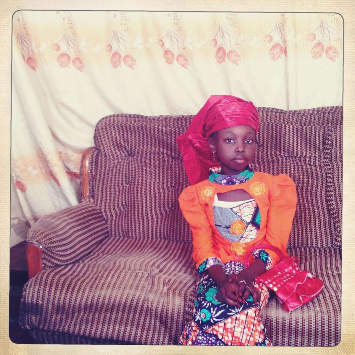 Wedding guest, all dressed up. Kano, Northern Nigeria. April 2013.