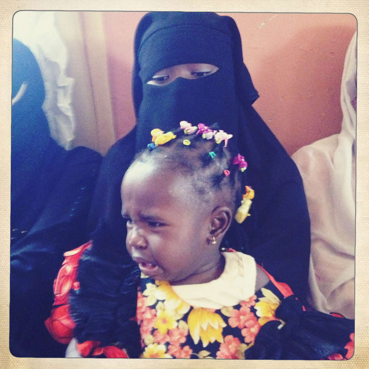 Tears and abayas. Joe, Central Nigeria. April 2013.