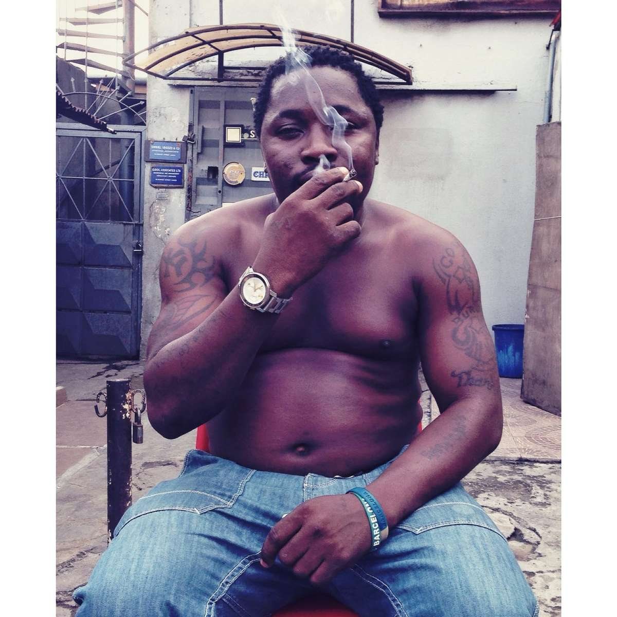 Area Boy smokes his morning J. Lagos, Nigeria. May 2014.