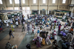 The train station fills with passengers before the trip to the North. Most of the passengers are Northerns who can't afford to fly or who are carrying to many goods or too much luggage to travel by road. Some Southerns also use the train as a {quote}local{quote} - taking it only a few hours north of the starting point in Lagos.