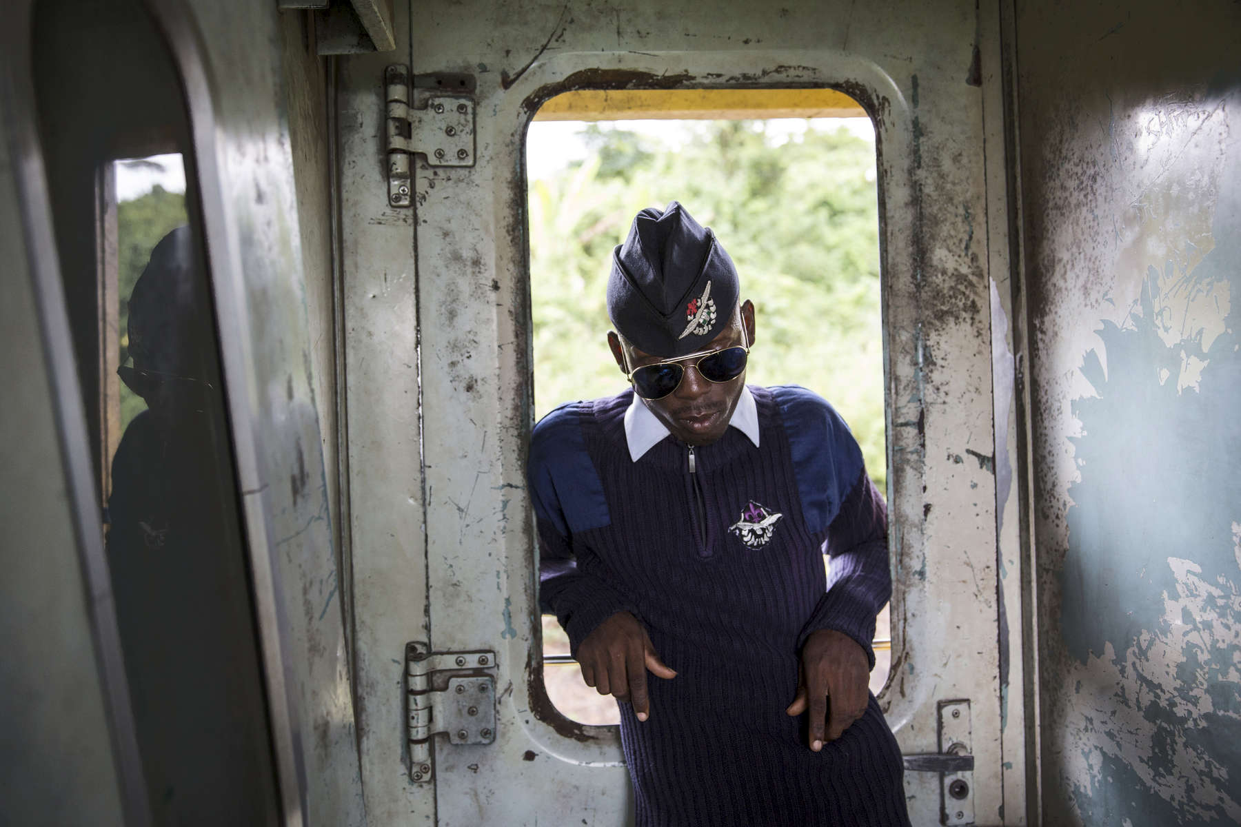 Onus Raymond wears his air force uniform for the train ride north. He spent most of the journey hanging out in between the cars by the doors, like in this space, or in the restaurant and bar car, which was mainly empty as most of the passengers are Northern Muslims who don't drink alcohol. 07063139220
