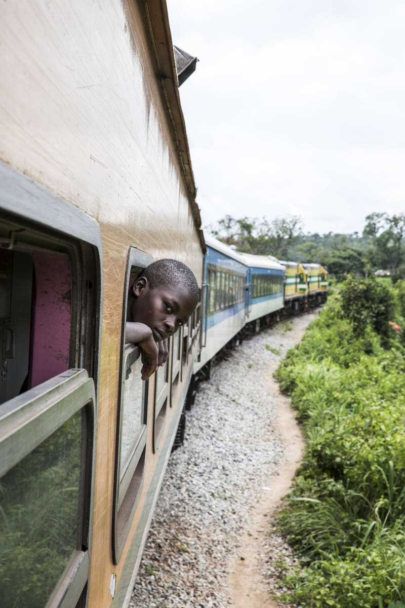 Jerry David, age 13, looks out the train window. He's traveling from Ibadan to Kano to visit his uncle. It's his fifth time taking the train, which he prefers to the road, but he hopes to one day take an airplane.His sister's phone number: 08137385515
