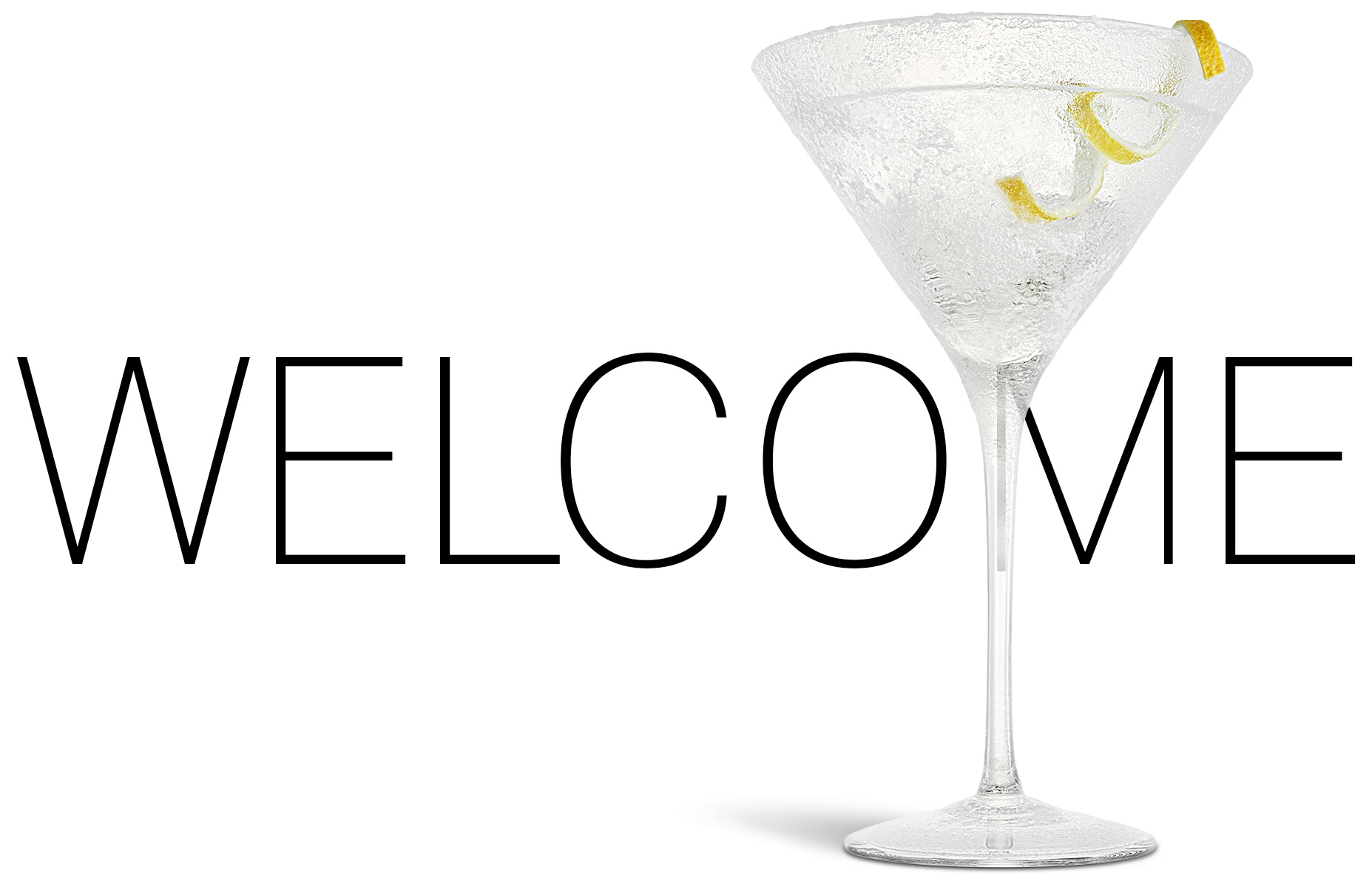 A simple welcome home page for the Zack Burris Photography web site includes a dry martini in a frozen glass with lemon twist on white. The camera angle is at 0º with light from the left and cropped in a landscape orientation.