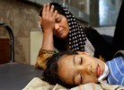 Sahara Ibrahim holds her head in grief while her daughter, Zena Jassim, 9, lays unconscious at Saddam Children's Park Nurse Villa Hospital in Baghdad, Iraq. Zena has been diagnosed with meningitis. Doctors said that the war environment caused a breakdown in public health services. The combination of poor sanitation and untreated water have led to an increase in infectious disease. (Chris Schneider/EW Scripps)