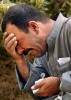 An Iraqi man cries as members of his family are unearthed at Saddam Children's Park Nurse Villa Hospital in Baghdad, Iraq. During the war so many unidentified bodies piled up at the hospital that they had to bury them on the grounds. The volunteers dig up the buried dead so the family can identify them and then take them away for a proper burial.  (Chris Schneider/EW Scripps)