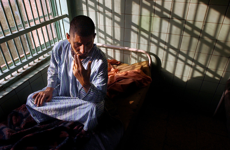 As evening comes a mental patient sits on his bed at Rashad psychiatric hospital Wednesday.