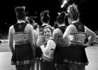 Megan Bomgaars, 14, waves to friends and supporters at the State Cheerleading finals at the Denver Coliseum in Denver, Colorado. Megan, who has Down Syndrome, tried out and made it onto the Evergreen High School cheerleading squad. The girls on the squad have rallied around Megan and made sure that she is part of the team.