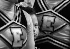 With butterflies in her stomach, Megan Bomgaars, 14, waits to compete with her fellow cheerleaders at the State Cheerleading finals at the Coliseum in Denver, Colorado.