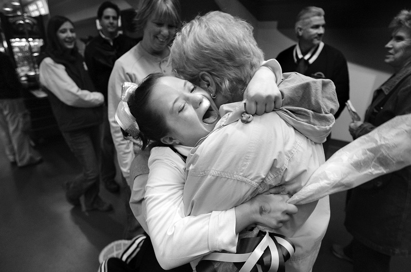 Megan Bomgaars, 14, gets a triumphant hug from her grandmother Barb McKeown after competing in the State Cheerleading Championships.