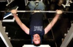 Jonathan Swain bench presses at his gym in Vernal, Utah. Jonathan works out as often as he can but his job and his health can interfere. Sometimes he feels to sick to work out.