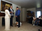 Alicia crawls between the legs of Jonathan in the middle of his wedding ceremony to Amber at their home in Vernal, Utah. Amber's family are devout Mormons and were hesitant to accept their daughter's relationship with Jonathan.