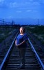 Nancy Alles Stroh stands on the tracks at the place where the school bus she was riding was hit by a passenger train on Dec. 14, 1961. Nancy suffered broken vertebrae and ribs. Several of her relatives were killed in the accident.
