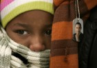 Ranoah Johnson, 8, waits for President-Elect Barack Obama to speak to a crowd estimated at 30,000 at the War Memorial Plaza during a Whistle Stop Tour in Baltimore, MD, on Saturday, Jan. 17, 2008, just days before the inauguration.