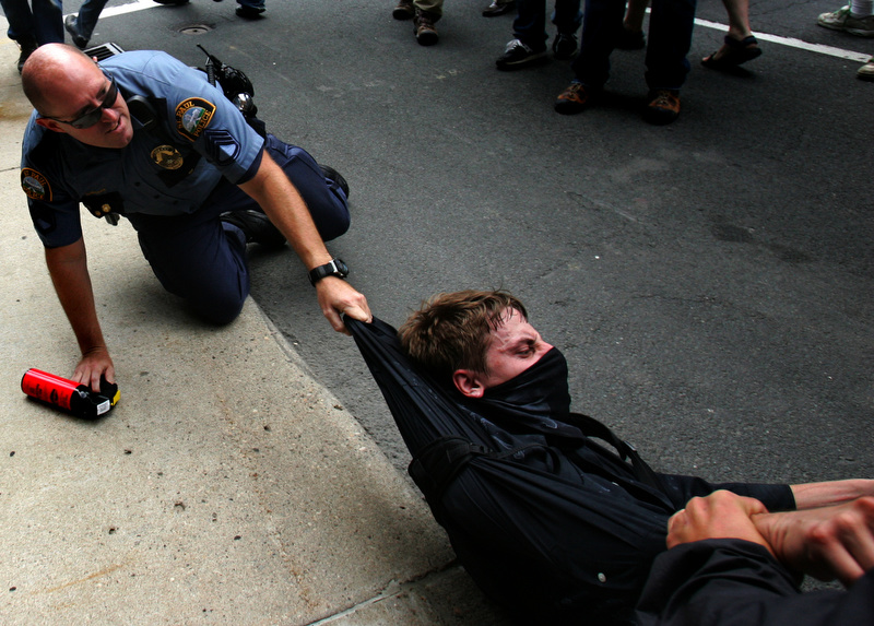 A police officer tries to arrest a protestor in downtown St. Paul before the start of the Republican National Convention in St. Paul, Minnesota on Monday, September 1, 2008. (Photo by Chris Schneider)