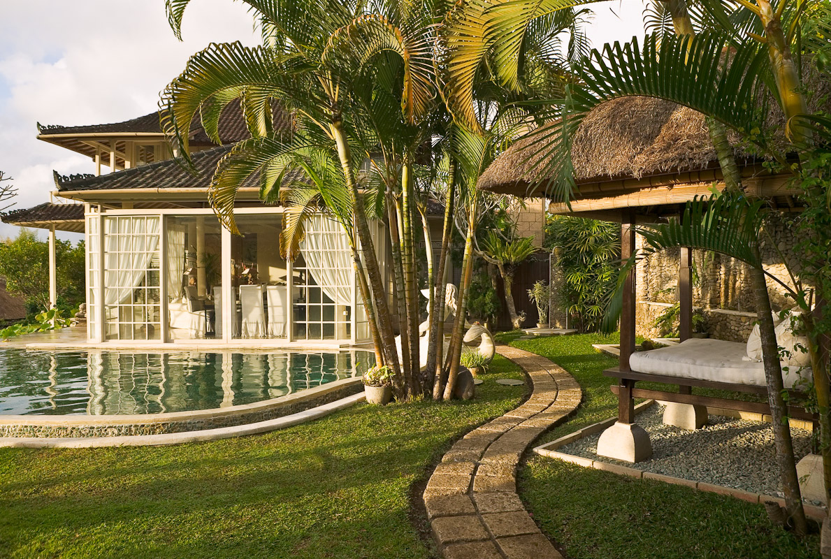 Beautiful home with swimming pool at the edge of a rice paddy. Photo by Jay Graham