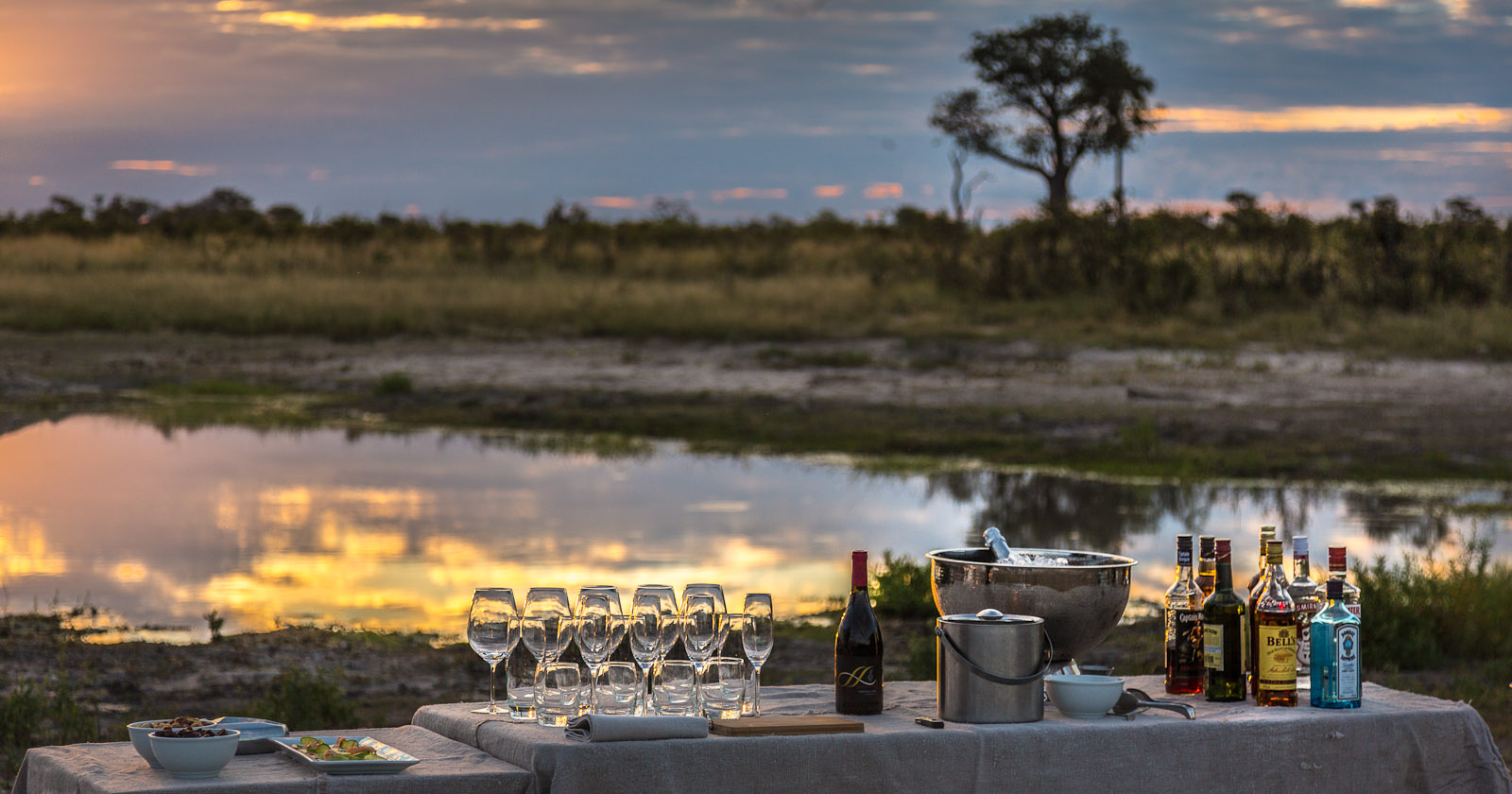 Sundowner set up near Abu Camp in the Okavango Delta, Botswana. Artfully laid out by Takesure for guests who have been interacting with Abu Camps elephant herd. Photo © 2012 Jay Graham, all rights reserved