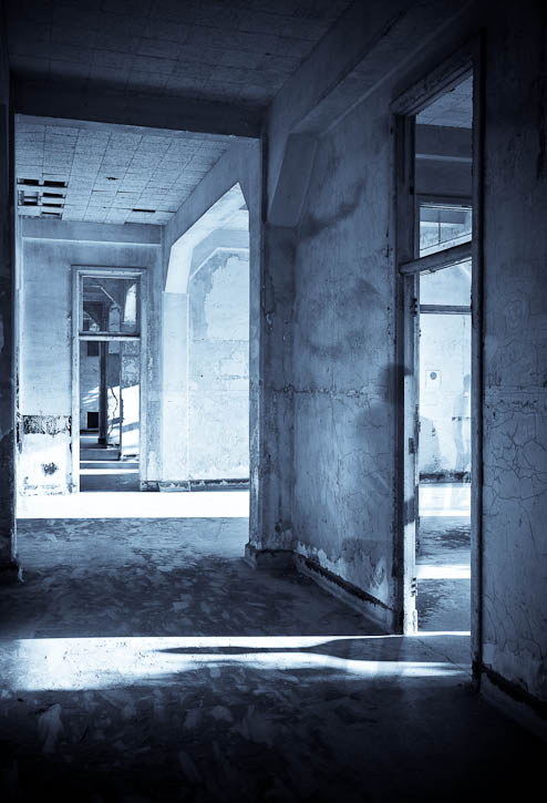 Interior shot of the hospital on Angel Island with three ghost figures. This photo won 3rd place in the historical architectural category in the International Photography Awards (IPA) 2009. Photo by Jay Graham
