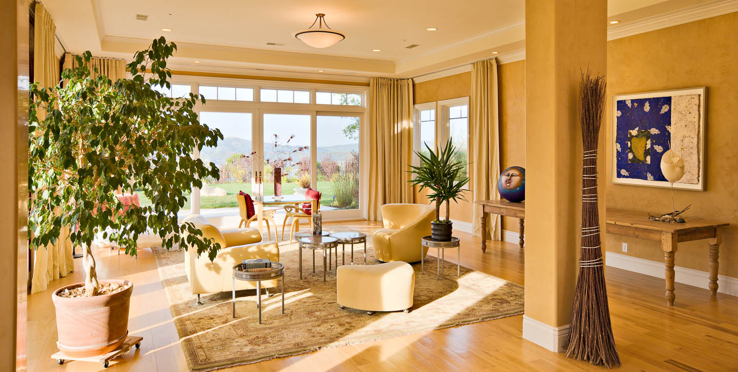 Stunning family room with pecan floors and San Francisco Bay and Golden Gate Bridge views.Photo by Jay Graham for Decker Bullock Sotheby's International Realty