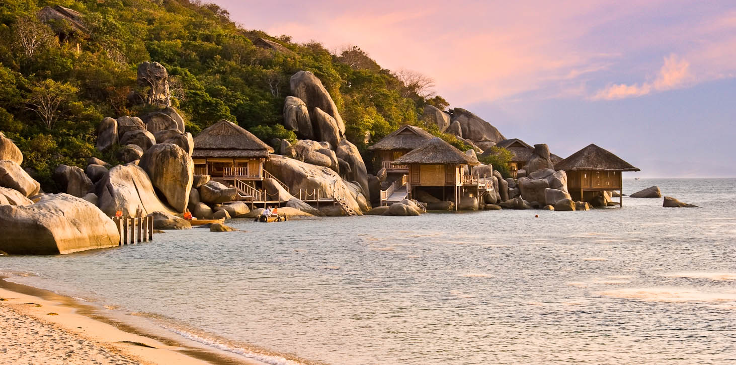 Six Senses Hideaway Ninh Van Bay sits on dramatic Ninh Van Bay, with its impressive rock formations overlooking the South China Sea, white sand beach and towering mountains behind, all adding to the sense of being luxuriously at one with nature. The exclusive property also presents the reality of the destination, with an architectural style reflecting the traditions of Vietnam. Photo by Jay Graham