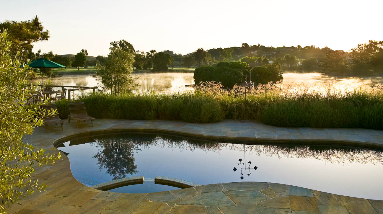 A beautiful back yard pool with stone work overlooking the lagoon at Peacock Gap, San Rafael, CA. Photographed by Jay Graham Photographer for Randy Thueme Design.