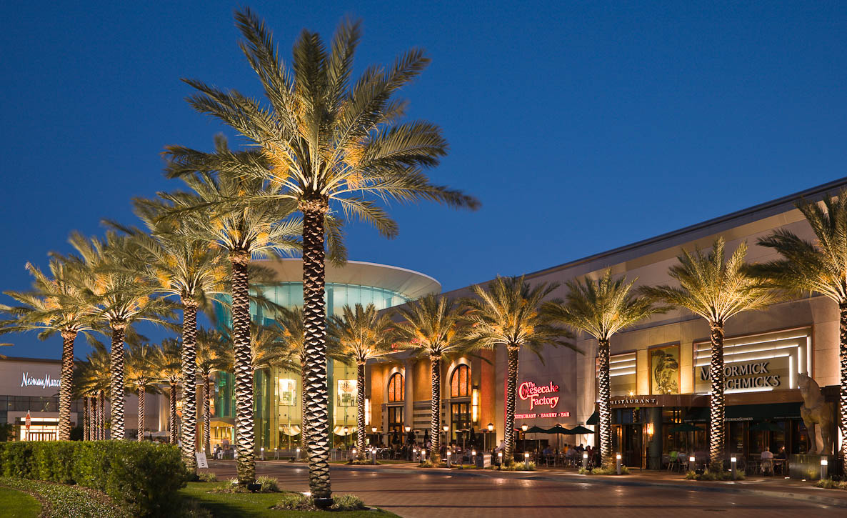 The Mall at Millenia treats guests to a sensory experience. Breathtaking architecture creates a distinct environment that exceeds all expectations. The latest runway fashions from NY, London, Paris and Milan are broadcast on LED screens atop 35-foot high masts. Amenities such as valet parking, multi-lingual guest services personnel, foreign currency exchange, and global shipping at a U.S. Post Office are offered to enhance the shopping experience. Photographed by Jay Graham for ValleyCrest Companies.