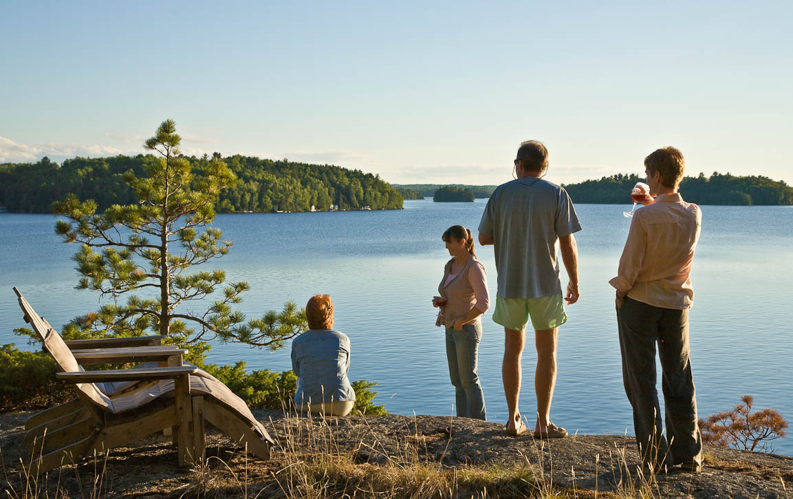 Friends and family enjoying the golden hour on Waters Island in Burntside Lake at the edge of the Boundry Waters in northern Minnesota. Photo by Jay Graham
