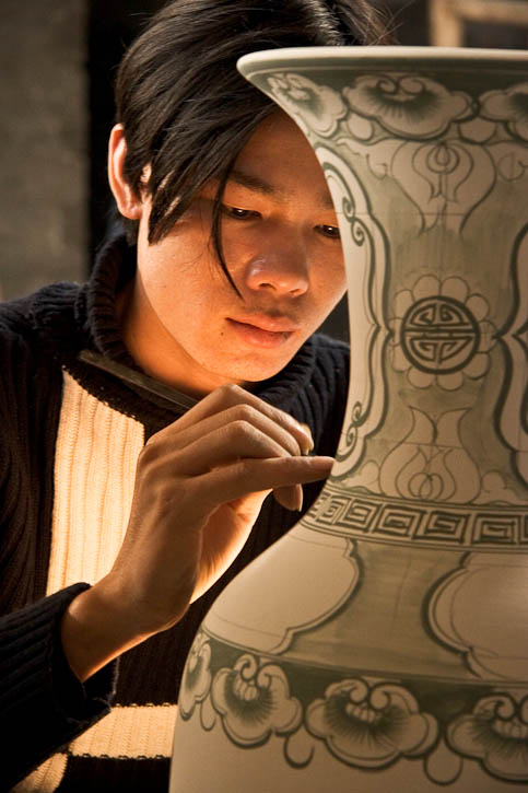 An artist in a ceramics factory near HaNoi, Vietnam. Photo by Jay Graham