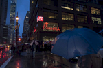Crowds line up outside the first  Chick-fil-A store in Manhattan on the eve of its grand opening