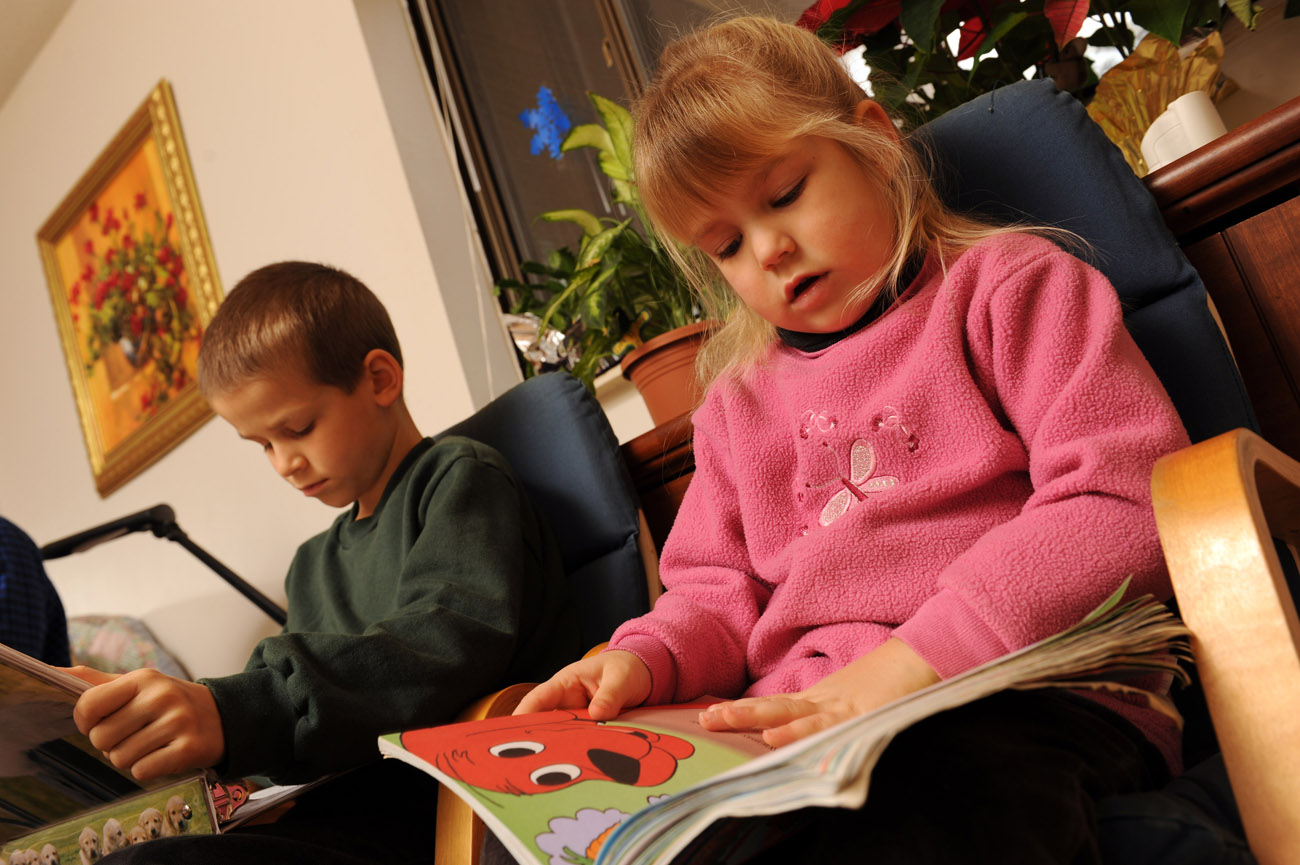 Christian  and Demaris read their favorite books for fun when not playing outside their home.