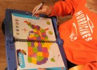 Joshua Romeike studies the United Staters map to memorize the capital cities of each state.