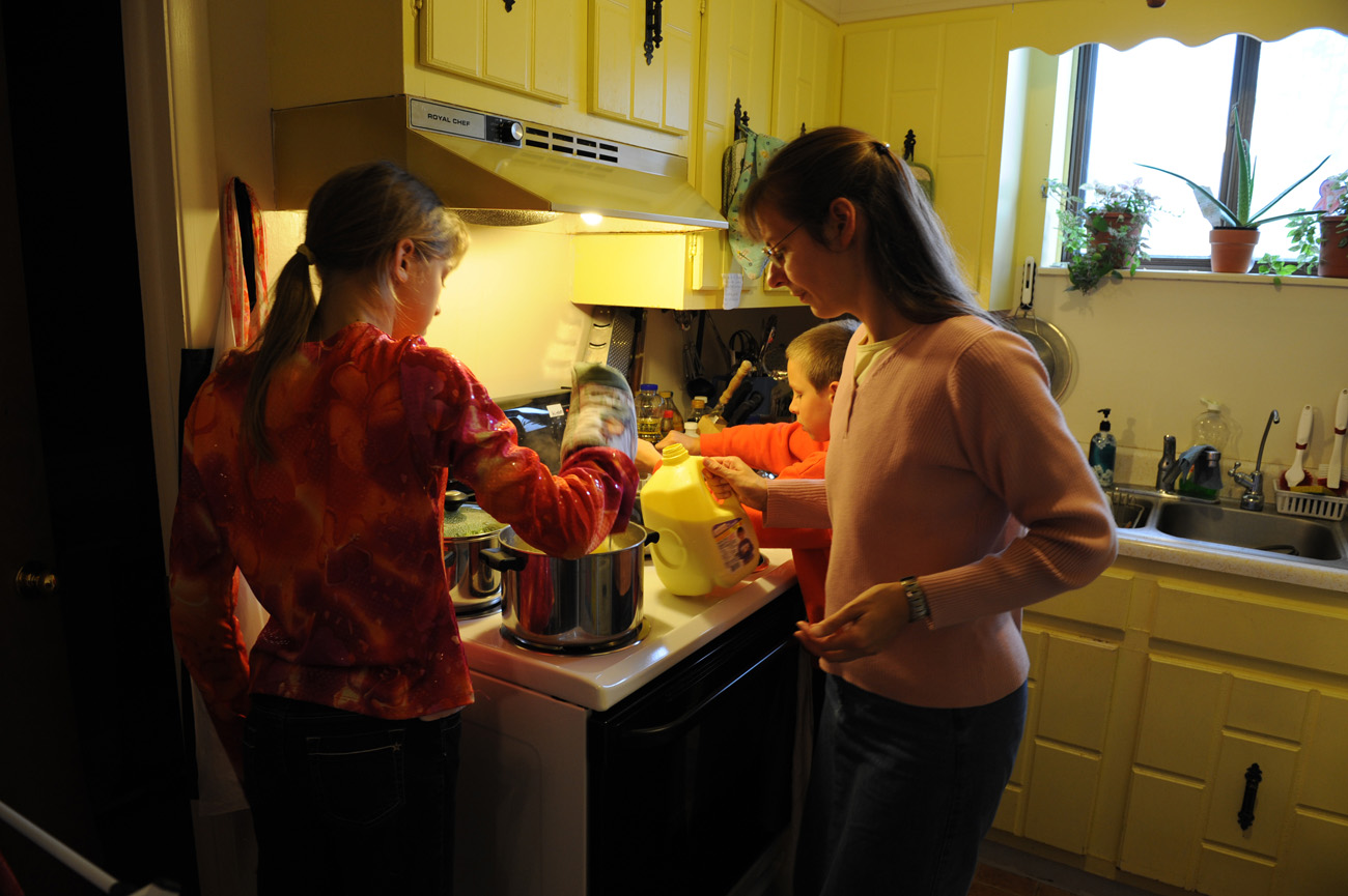 Lydia and Joshua help their mother  prepare lunch in the Romeike's small kitchen.