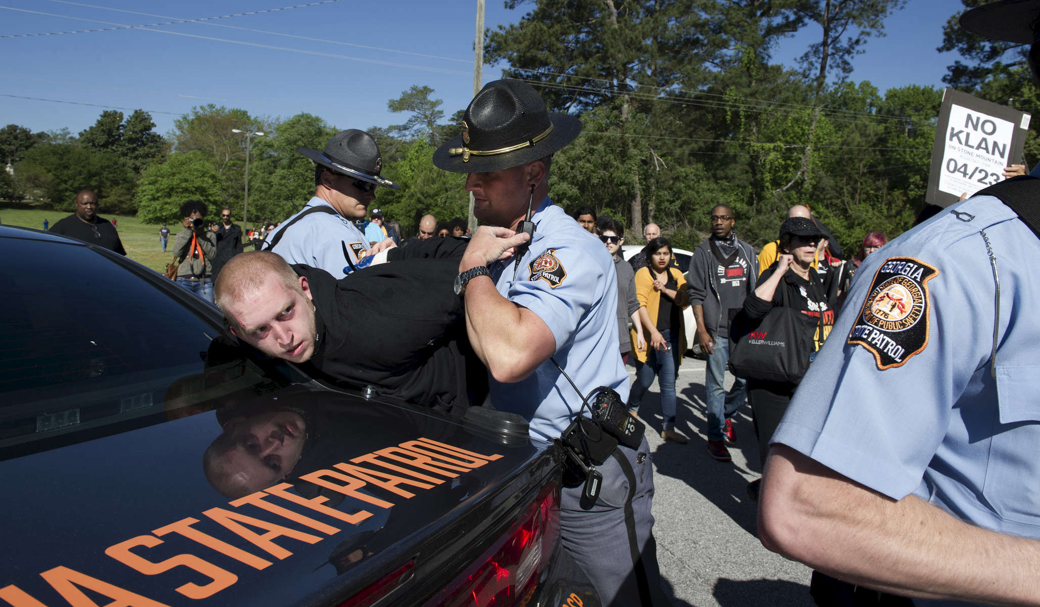 Police arrest members of an anti-Ku Klux Klan protest group known as All Out ATL that mobilized to shut down a KKK rally in the Stone Mountain park. Hundreds of marchers were met by dozens of police and state troopers, many in riot gear. The anti-white supremacist  group hoped to thwart  the permitted rally, which was only sparsely attended.