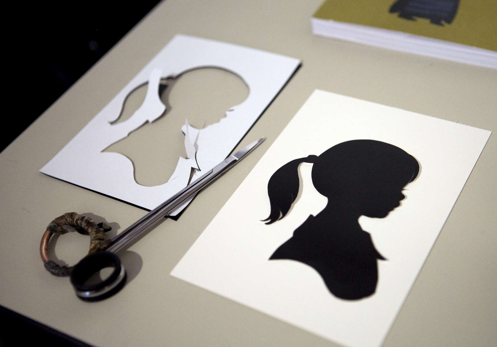 Silhouette artist Karl Johnson creates miniature shadow masterpieces freehand, one of about a dozen people in the United States who make their living in this field.