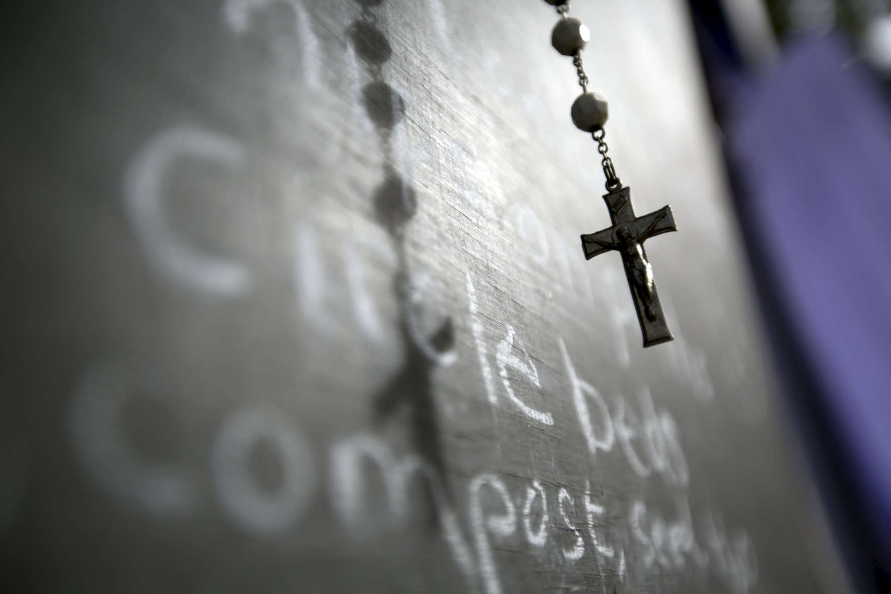 A rosary hangs on a message board in the Greeley Forest Garden in Portland, September 16, 2015. Organizers at the nonprofit Greeley Forest Garden want to partner with other area nonprofits to bring services to the camp, which is on an adjacent lot. Kristyna Wentz-Graff / Staffreligion Catholic