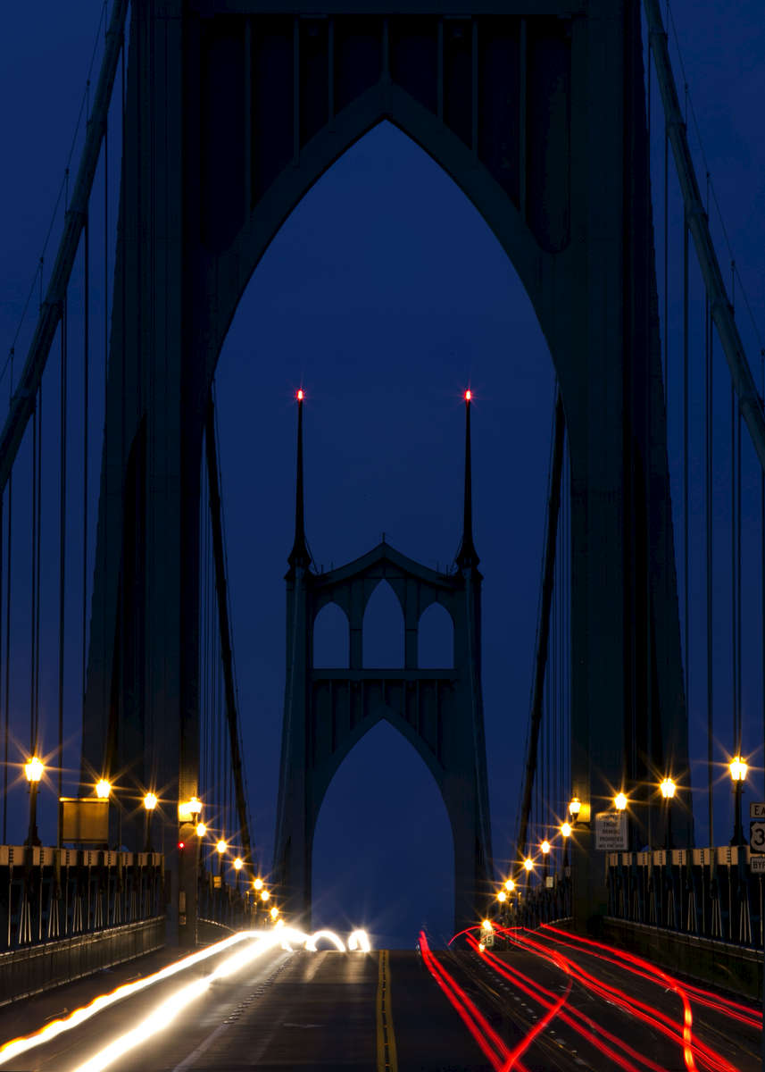 The St. Johns Bridge in Portland is a steel suspension bridge crossing the Willamette River. The Gothic-styled bridge took 21-months to build and was dedicated in 1931.