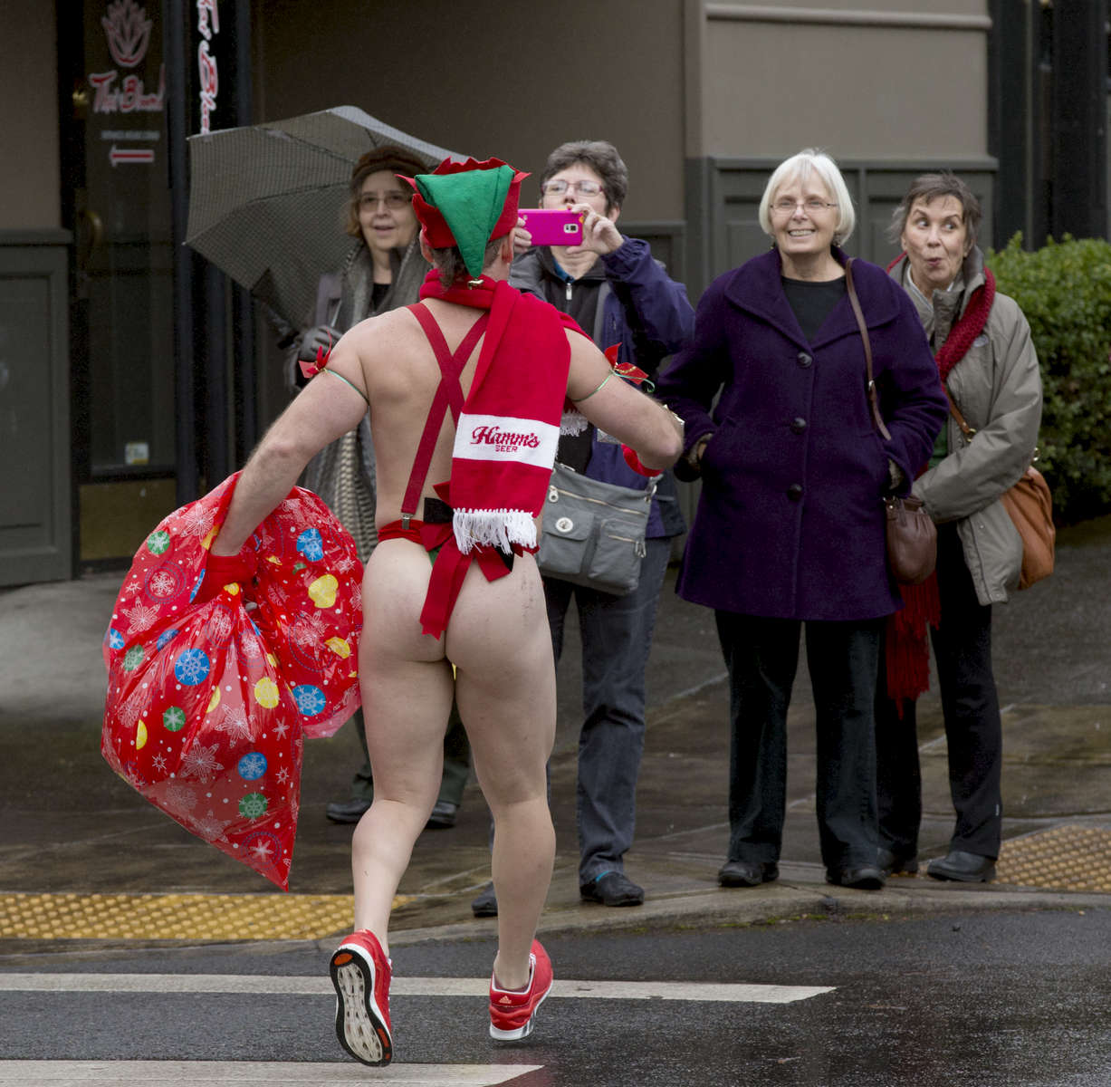 A Santa Speedo participant brings holiday cheer to onlookers as he runs through the streets in northwest Portland in 2014 during the Santa Speedo Run. The event is a fundraiser for the non-profit Ethiopia Project and raised $3000 dollars with the run.