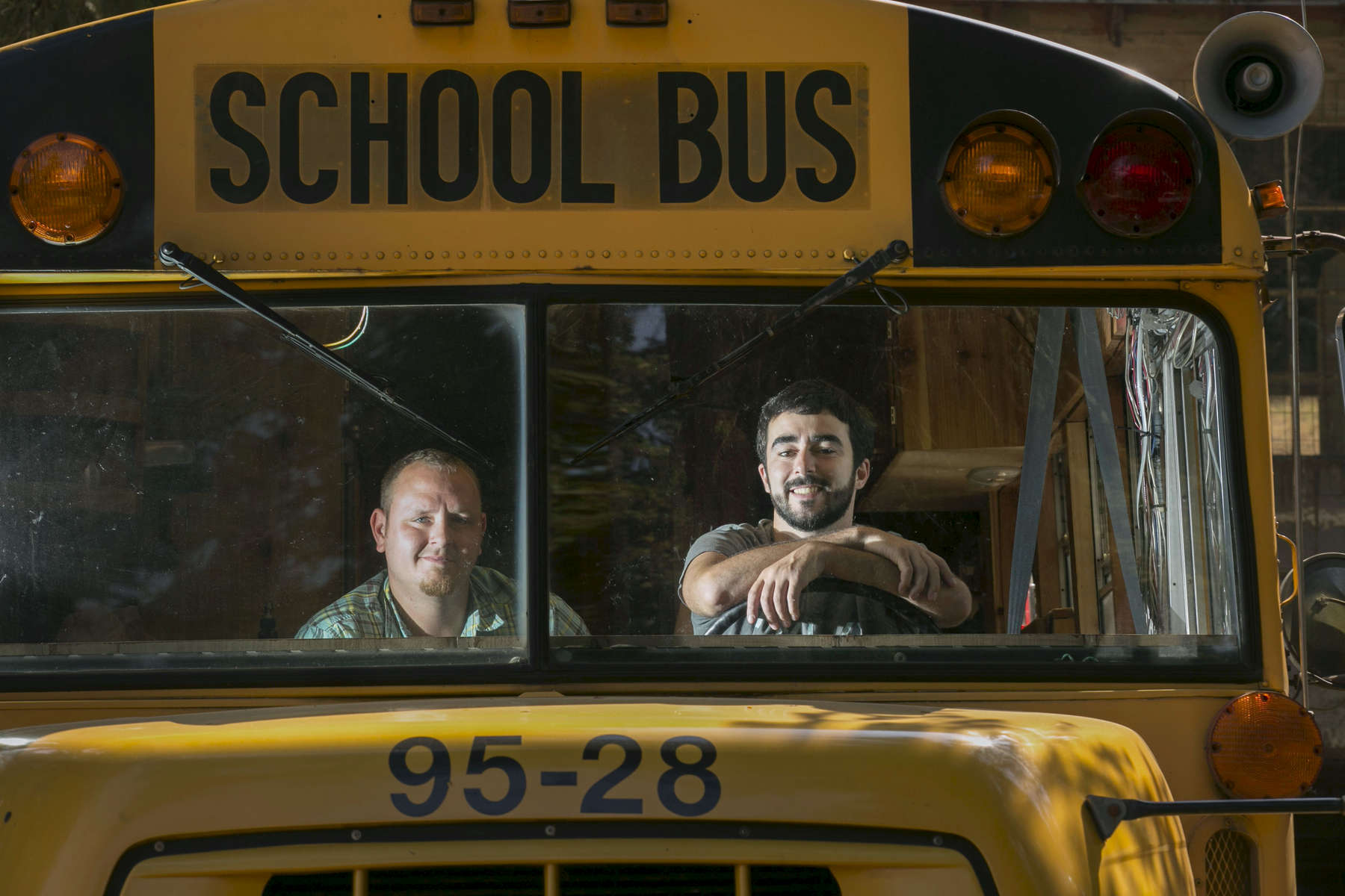 Matthew Johansen (left) and Jeff Sarault, in their 1995 Ford school bus which they have had converted into a RV, a practice known as {quote}skoolie conversion.{quote}