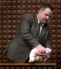 In a horrifying display, Milwaukee Det. James Hutchinson uses a doll to demonstrate how foster mother Crystal Keith admitted she positioned and held her 13-month-old foster son, as Hutchinson testifies in Keith's trial. Hutchinson stated this was the worst case of child abuse he had ever seen.