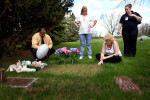 Following the conclusion of Crystal Keith's trial, a group of citizens arrived at Christopher Thomas's tiny grave. The grave is unmarked, save for a pile of stuffed animals and a thin layer of newly-seeded grass.